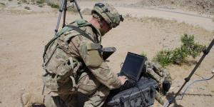 A soldier with the 780th Military Intelligence Brigade sets up cyber tools at the National Training Center as part of the U.S. Army's cyber electromagnetic activities (CEMA) initiative led by Army Cyber Command. The service is consolidating electronic warfare and cyber training and operations at Fort Gordon, Georgia, facilities to integrate all aspects of the disciplines.