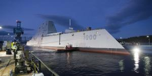 The U.S. Navy's newest destroyer, the USS Zumwalt, departs its dry dock at Bath Iron Works, Maine, prior to conducting at-sea trials in the Atlantic Ocean. The technology-rich Zumwalt may serve as a template not only for future Navy ships but also for a highly skilled crew capable of handling multiple tasks.