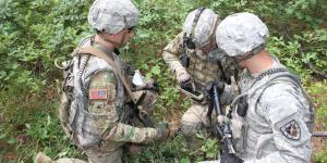 Soldiers from the Fort Benning, Georgia, Experimental Force, Alpha Company, 1st Battalion, 29th Infantry Regiment, assess capabilities on mobile devices during a field-based risk-reduction event at Joint Base McGuire-Dix-Lakehurst in New Jersey.