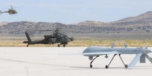 The OH-58D Kiowa Warrior, AH-64D Apache Longbow and Warrior Alpha land at Michael Army Airfield, Utah, in 2011, after the Manned-Unmanned Systems Integration Capability exercise. The aircraft joined with the RQ-11B Raven and MQ-5B Hunter to demonstrate their interoperability.