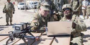 U.S. Army Chief of Staff Gen. Mark A. Milley, USA, visits soldiers serving with the cyber electromagnetic activities (CEMA) support to corps and below (CSCB) team, 780th Military Intelligence Brigade, in May at the National Training Center in Fort Irwin, California. Photo by Sgt. 1st Class Chuck Burden, USA