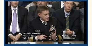 Adm. Michael Rogers, USN, director of the NSA and commander of U.S. Cyber Command, testifies during a Senate hearing on Thursday on foreign cyberthreats to the United States.