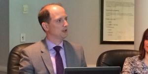Jonathan Williams, an attorney with PilieroMazza PLLC, discusses new rules of the SBA's mentor-protege program during a meeting of AFCEA International's Small Business Committee.