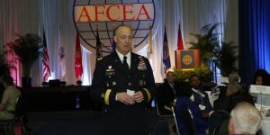Lt. Gen. Alan R. Lynn, USA, director, Defense Information Systems Agency and commander, Joint Force Headquarters, Department of Defense Information Network, gives the keynote luncheon address amidst attendees at Defensive Cyber Operations Symposium 2016 in Washington, D.C.