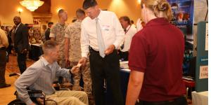 A service member networks with employers during the Hiring Heroes Career Fair at Marine Corps Base Camp Pendleton, California.