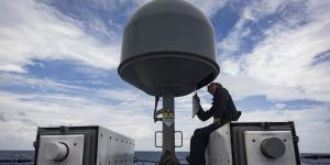 Information Systems Technician 2nd Class Austin Vosburg, USN, performs routine maintenance on the USS Zephyr's commercial broadband satellite program equipment. The maritime family of SATCOM terminals provides high data rate communications to small and large ships.