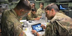 Maj. Matthew Bailey, USA, executive officer, 3rd Squadron, 2d Cavalry Regiment (3/2CR), and 1st Lt. Trevor Rubel, USA, battle captain for the tactical command post, 3/2CR, review an operational overlay on a Nett Warrior device in preparation for an airfield seizure during the NATO Saber Strike 18 exercise in Kazlu Ruda, Lithuania. U.S. Army photo by 1st Lt. Joshua Snell