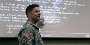 A Louisiana Army National Guard chief communications plans officer trains members of the Cyber Defense Incident Response Team to defend the state's cyber assets in November 2015. Photo courtesy DOD