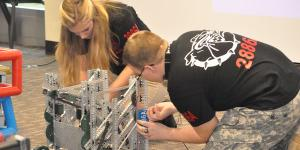 Students from Central Hardin High School in Cecilia, Kentucky, prepare their robotics entry for a Project Lead the Way (PLTW) competition. An AFCEA scholarship funded teacher training for PLTW—a leading provider of K-12 STEM programs—at the University