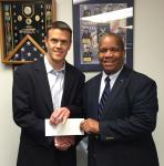 Matt Stratford, managing principal, BridgePhase LLC (l), presents a $3,000 check to AFCEA Educational Foundation Executive Director Vince Patton to sponsor the 2016 BridgePhase STEM Major Scholarship.