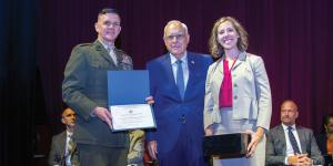 "Lt. Gen. Otto Guenther, USA (Ret.) (c), presents the AFCEA ""Sparky"" Baird Award for Research Excellence in June to Maura K. Styczynski for her paper ""Blockchain: Buzzword or Breakthrough"" at the Dwight D. Eisenhower School for National Security and Resource Strategy alongside the school's commandant, Maj. Gen. John Jansen, USMC."