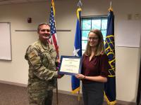Undergraduate STEM Diversity Scholarship winner Lara Quiring receives her certificate from Col. Sean Murphy, USAF, chapter president, at the Greater Omaha Chapter luncheon in August.