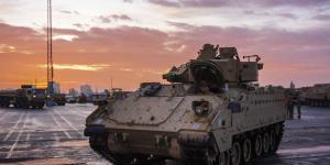 An Army Bradley fighting vehicle armored personnel carrier waits to board a vessel at the port of Bremerhaven, Germany, last October, while supporting Atlantic Resolve, a mission demonstrating continued U.S. support for NATO allies in Europe. The Joint Support and Enabling Command (JSEC) will follow the lead of the Supreme Allied Commander Europe, or SACEUR, in providing deployment assistance in Europe to the U.S. and other NATO militaries.  U.S. Army Sgt. Thomas Mort