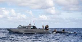 Sailors deployed with the expeditionary mine countermeasures capability of Task Force 75 and Special Warfare Combatant-Craft Crewmen recover a MK 18 Mod 2 unmanned underwater vehicle (UUV) onto a combatant craft in Pago Bay, Guam in November. The Navy is working to add considerable unmanned capability to the fleet with UUVs and unmanned surface vehicles of all sizes to support a number of naval missions.  U.S. Navy photo by Petty Officer 1st Class Adam Brock