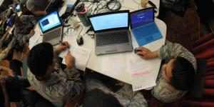 Hawaii Air National Guardsmen evaluate network vulnerabilities during the Po'oihe 2015 cybersecurity exercise at the University of Hawaii's Information Technology Center. The cybersecurity exercise is part of a hurricane preparedness effort that encompasses several state and federal government organizations.