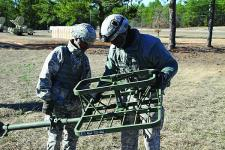 Two signal soldiers set up an antenna at a training site in Fort Gordon, Georgia. Keeping signaleers up-to-date is a primary challenge, as the development of new technologies is outpacing the ability to train.