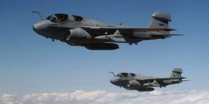 Two EA-6B Prowler electronic warfare aircraft fly over Turkey to support combined task force operations. The analog-to-digital converter chip being developed by DARPA ultimately could benefit a wide range of communications, radar and electronic warfare systems.