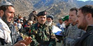 Col. Greg Julian, USA, public affairs officer for the U.S. Forces Afghanistan, leads an investigation team to meet with villagers in Tagab, Afghanistan. The team worked with the Afghan ministries of Defense and Information to explore allegations of possible civilian casualties after a mission to capture Taliban leaders.