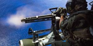 A U.S. Marine Corps corporal fires a GAU-17/A gun during a Valiant Shield exercise over Farallon de Medinilla, Northern Mariana Islands. Machine-learning software may help predict which warfighters will be best suited for specific missions.