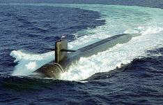 The U.S. Navy's nuclear ballistic submarine USS MAINE, one of the nation's newest Ohio class submarines, conducts surface navigational operations approximately 50 miles due south of Naval Station Roosevelt Roads, Puerto Rico. The Naval Research Laboratory's cryptographic system now destined for aircraft has already been integrated onto the Navy's nuclear fleet.