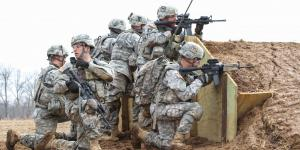 Soldiers from the 101st Airborne Division use Rifleman Radios and other tactical network technologies during a training exercise. In the future, Army officials intend to provide soldiers with a radio capable of using both the Soldier Radio Waveform, which the Rifleman Radio relies on, and the Single Channel Ground and Airborne Radio System waveform.