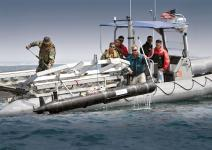 SPAWAR Systems Center Pacific personnel and sailors from Explosive Ordnance Disposal Mobile Unit ONE retrieve an unmanned underwater vehicle deployed to detect mines and improvised explosives in shallow water environments.