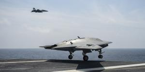 The X-47B unmanned air vehicle takes off from the deck of an aircraft carrier. The U.S. Navy recently conducted the fifth series of at-sea tests, proving that a manned and unmanned aircraft can maintain a takeoff and landing pattern aboard an aircraft carrier.