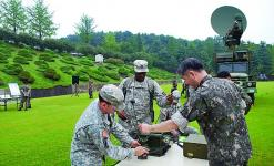 U.S. and Republic of Korea officers set up a U.S. army radio for Korean communications. U.S. signal assets are being upgraded to provide ensured connectivity and greater joint and coalition interoperability.