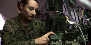 Sgt. April Vance, USMC, a field radio operator with Headquarters Regiment, 1st Marine Logistics Group, adjusts the communications network during a field training exercise at Camp Pendleton, California. Field radio operators employ a range of frequencies to establish communications, including ultrahigh frequencies, upper-very-high frequencies and high frequencies.  U.S. Marine Corps Photo by Staff Sgt. Rubin J. Tan, USMC
