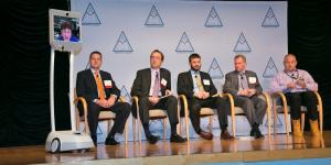Dallas Goecker joins a panel discussion on mobility from Indiana via a robotic telepresence device developed by Suitable Technologies to facilitate remote collaboration. Goecker was a panelist at Mobile Tech Summit held in Washington, D.C. Photo by Mike Carpenter