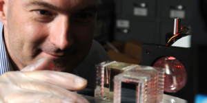 NRL's Christoph Englert examines the prototype Michelson interferometer (MIGHTI) being developed at NRL for flight on NASA's ICON mission.