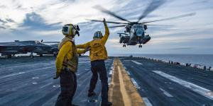 Sailors assist with the landing of a Marine Corps CH-53E Super Stallion helicopter on the deck of the U.S. Navy's USS Wasp assault ship as part of an April certification exercise in the Philippine Sea. In its role of steering the Navy toward the best information technology for the 21st century, the Space and Naval Warfare Systems Center (SSC) Atlantic is looking at cloud computing systems to support the warfighter. Credit: Petty Officer 3rd Class Levingston Lewis, USN