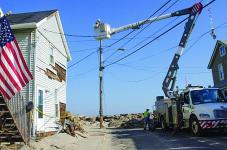Crews work in New Jersey to restore power that was knocked out during Hurricane Sandy. GridCloud, a project between Cornell University and Washington State University, employs cloud technology to make smart grids self-healing and more resilient in the event of natural or man-made disasters. Photo Credit: FEMA/Liz Roll