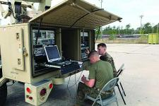 The U.S. Marine Corps is developing a private cloud computing environment to provide better information services to the tactical edge. Here, communicators set up a Support Wide Area Network System during a training exercise.