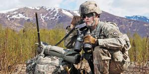 A forward observer reports during an exercise with the Advanced Field Artillery Tactical Data System. This system will benefit from the multidomain operation capabilities under development by the PEO IEWS.  U.S. Army