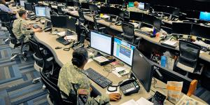 Soldiers at the U.S. Army Cyber Operation Center at Fort Gordon monitor networks for possible attacks by adversaries. The Army is striving to bring signal, cyber and military intelligence together in a partnership to meet challenges in the changing information environment.