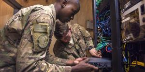 Two U.S. Air Force airmen install network-switch panels at Bagram Airfield, Afghanistan. The Defense Information Systems Agency (DISA) is striving to improve its acquisition processes to procure and deploy innovative information technologies to its customers more quickly.