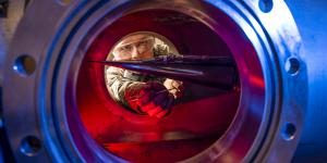 An Air Force Academy cadet peers into a wind tunnel used for measuring effects on hypersonic research vehicles. Development of new hypersonic craft is speeding up, but considerable research remains to overcome some technological challenges.  U.S. Air Force photo