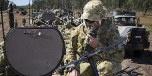 An Australian signalman communicates during Exercise Talisman Saber 17. The joint exercise with the United States is a vital part of Australia's efforts to improve communications and information systems interoperability as it modernizes its force.