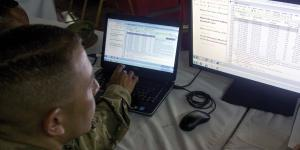 Servicemen participate in a cyber warrior exercise overseas. The U.S. Army's program executive officer for enterprise information systems (PEO EIS) is striving to speed new software into cyber systems while maintaining effective operations. U.S. Army Reserve photo
