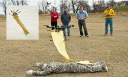 Scientists from the U.S. Army Research Laboratory test an unmanned system to deliver a blanket to a wounded soldier, part of a developing concept to use unmanned assets as protective platforms.