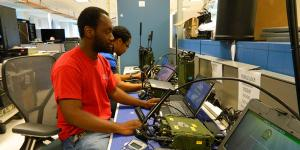 Product Manager Handheld, Manpack and Small-Form Fit engineers perform tests on the manpack radio in the Unified Lab for Tactical Radios–Army (ULTR-A) facility in Maryland. The ULTR-A lab is used for radio and waveform testing and integration.