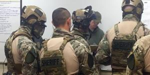 SWAT teams receive a training scenario briefing during September's Urban Shield in California.
