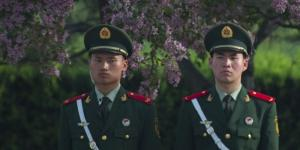 People's Liberation Army (PLA) personnel stand in front of the Great Hall of the People in Beijing. Long-standing traditions, beliefs and doctrine underpin many PLA activities in cyberspace.