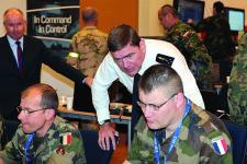 Gen. Stephane Abrial, FRA, Supreme Allied Commander Transformation (ACT), observes part of the Coalition Warrior Interoperability Exercise (CWIX) 12 held in June. The exercise helped validate the effectiveness of the new Tactical Edge Data Solutions (TEDS) joint capability technology demonstration (JCTD).