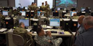 As part of the nine-day Cyber Guard exercise, participants work through a training scenario. Credit: Navy Petty Officer 2nd Class Jesse A. Hyatt, USN