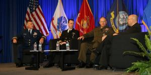 From l to r, service chiefs from the U.S. Coast Guard, Navy and Marine Corps address critical issues facing the U.S. military. Photo by Mike Carpenter