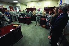Brig. Gen. John Baker, USA, J-6, U.S. Central Command (CENTCOM), addresses his staff at a ceremony honoring Col. Edward Cobb, (decesased) USA, former J-6 of the precursor to CENTCOM.