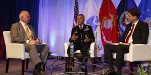 From l-r, Francis Rose of Government Matters moderates a fireside chat with Gen. Paul Nakasone, USA, director of the NSA and commander of U.S. Cyber Command, and Dana Deasy, Defense Department CIO, at TechNet Cyber. Photo by Michael Carpenter