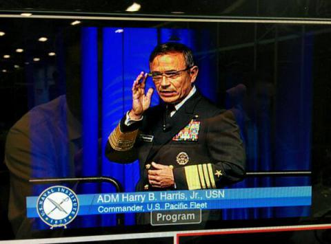Adm. Harry B. Harris Jr., USN, uses Google Glass as a teleprompter at WEST 2014.